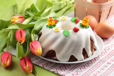 holiday meal: Easter cake, eggs and bunch of tulips Stock Photo