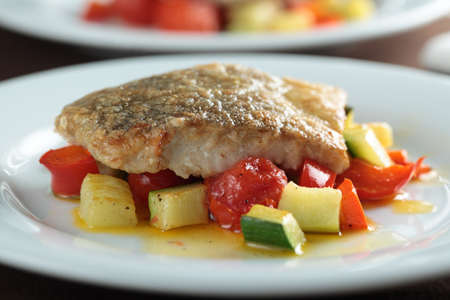 Roasted hake fillet with vegetables photo