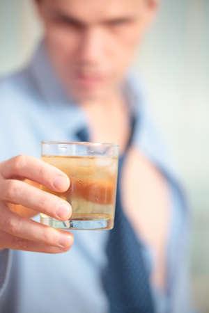 Drunk businessman holding a glass photo