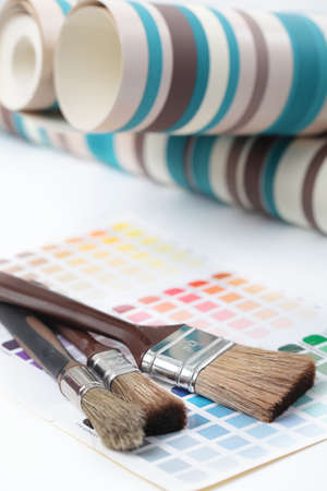 Wallpapers and paintbrushes on a color swatch photo