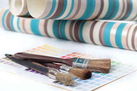 Wallpapers and paintbrushes on a color swatch
