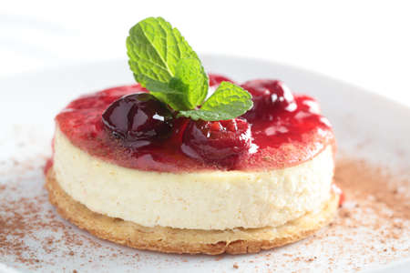Slice of cheesecake with cherry jam