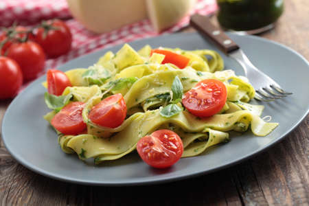 Pasta with pesto sauce, cherry tomato, basil, and cheese Stock Photo - 13033766
