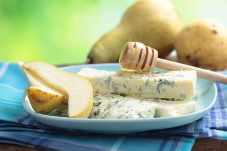 Blue cheese, sliced pear, and honey on a plate Stock Photo - 13032340