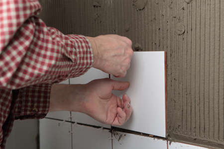 Contractor installing tiles on a wall Stock Photo - 13033854