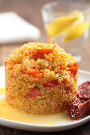 sundried: Bulgur pilaf with pepper and sun-dried tomatoes