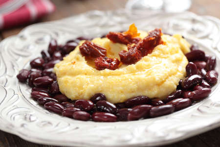 Polenta with red beans and sun-dried tomatoes photo
