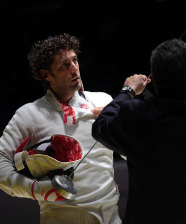 epee: KIEV, UKRAINE - APRIL 14, 2012: Member of Hungarian team Gabor Boczko with his epee before the fight during the World Fencing Championship on April 14, 2012 in Kiev, Ukraine Editorial
