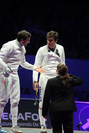 epee: KIEV, UKRAINE - APRIL 14, 2012: Hungarian Peter Somfai talk with Italian Enrico Garozzo during the match for 3rd place in mens epee competition during World Fencing Championship on April 14, 2012 in Kiev, Ukraine