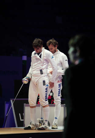 epee: KIEV, UKRAINE - APRIL 14, 2012: Diego Confalonieri replaced by Enrico Garozzo in the match for 3rd place in mens epee during World Fencing Championship on April 14, 2012 in Kiev, Ukraine