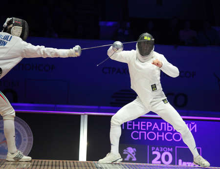 KIEV, UKRAINE - APRIL 14, 2012: Fight between Andras Redli, Hungary, and Matthew Trager, Italy, during World Fencing Championship on April 14, 2012 in Kiev, Ukraine Stock Photo - 13203942