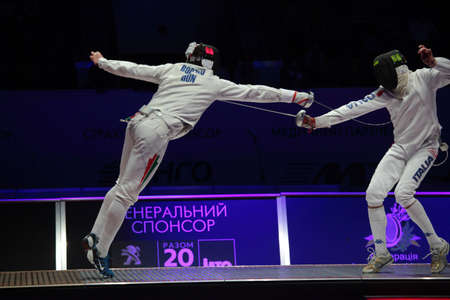 KIEV, UKRAINE - APRIL 14, 2012: Fight between Gabor Boczko, Hungary, and Diego Confalonieri, Italy, during World Fencing Championship on April 14, 2012 in Kiev, Ukraine Stock Photo - 13203967