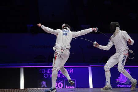 KIEV, UKRAINE - APRIL 14, 2012: Fight between Gabor Boczko, Hungary, and Diego Confalonieri, Italy, during World Fencing Championship on April 14, 2012 in Kiev, Ukraine Stock Photo - 13203958