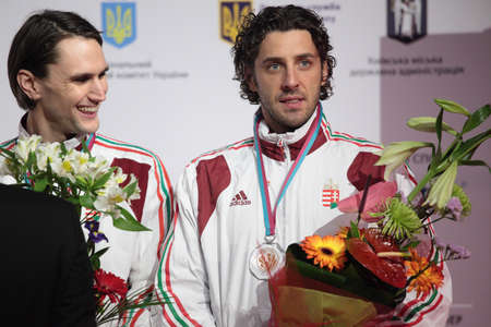 fencers: KIEV, UKRAINE - APRIL 14, 2012  Hungarian fencers Andras Redli and Gabor Boczko on medal ceremony during World Fencing Championship on April 14, 2012 in Kiev, Ukraine Editorial