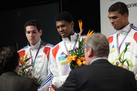 epee: KIEV, UKRAINE - APRIL 14, 2012  French men s epee team on medal ceremony of World Fencing Championship