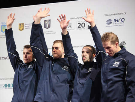 epee: KIEV, UKRAINE - APRIL 14, 2012  USA men s epee team on medal ceremony of World Fencing Championship