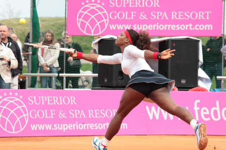 KHARKOV, UKRAINE - APRIL 22, 2012: Match between Serena Williams and Lesia Tsurenko during Fed Cup tie between USA and Ukraine in Superior Golf and Spa Resort, Kharkov, Ukraine at April 22, 2012