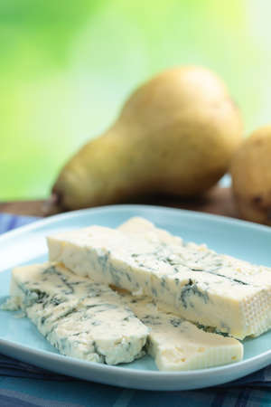 Blue cheese on a plate and pears photo