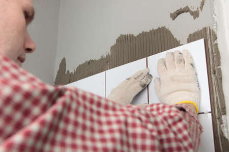 Contractor installing tiles on a wall Stock Photo - 13761906