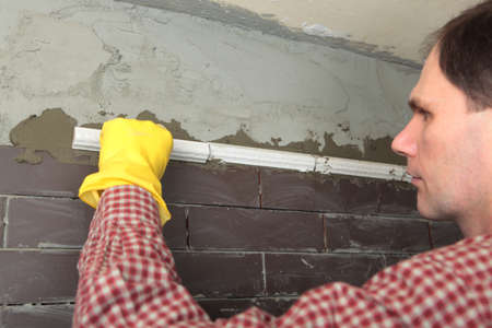 Contractor installing tiles on a wall Stock Photo - 13761992