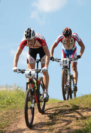 MOSCOW, RUSSIA - JUNE 9: Alexander Gehbauer (Austria, left) and Timofey Ivanov (Russia) in the European Mountain Bike Cross-Country Championship in Moscow, Russia at June 9, 2012