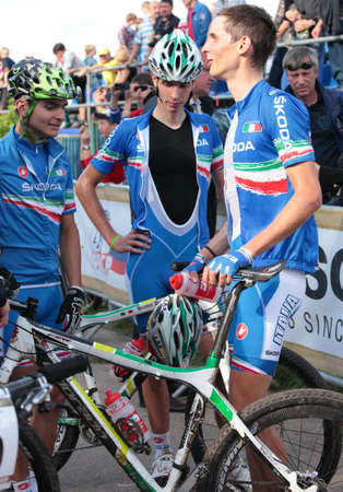 daniele: MOSCOW, RUSSIA - JUNE 9: Daniele Braidot (Italy, center) and Luca Braidot (Italy, right) talk with teammates after finish of the European Mountain Bike Cross-Country Championship in Moscow, Russia at June 9, 2012 Editorial