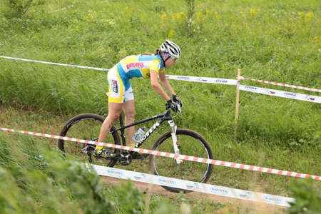 marta: MOSCOW, RUSSIA - JUNE 9: Marta Tereshchuk (Ukraine) races during the European Mountain Bike Cross-Country Championship in Moscow, Russia at June 9, 2012
