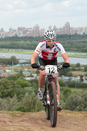 MOSCOW, RUSSIA - JUNE 9: Vivienne Meyer (Switzerland) races during the European Mountain Bike Cross-Country Championship in Moscow, Russia at June 9, 2012