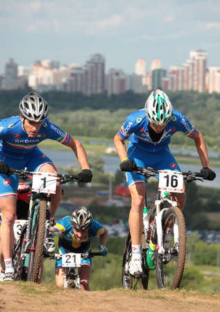 daniele: MOSCOW, RUSSIA - JUNE 9: Gerhard Kerschbaumer (Italy, left), Daniele Braidot (Italy, right) and Olof Jonsson (Sweden) in the European Mountain Bike Cross-Country Championship in Moscow, Russia at June 9, 2012