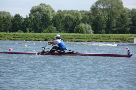 sculling: MOSCOW, RUSSIA - JUNE 9  Sergey Syichyov  Moscow  in rowing competitions on single scull during 51th International Grand Moscow Regatta in Moscow, Russia at June 9, 2012 Editorial