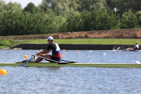 sculling: MOSCOW, RUSSIA - JUNE 9  Denis Kleshnev in rowing competition on single sculls during 51th International Grand Moscow Regatta in Moscow, Russia at June 9, 2012 Editorial