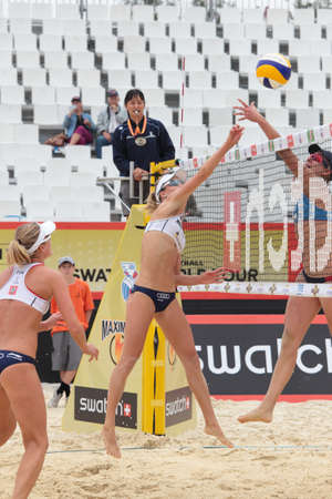jennifer: MOSCOW, RUSSIA - JUNE 8: Jennifer Kessy and April Ross (right), USA against Emilia (center) and Erika (left) Nystrom, Finland, during Beach Volleyball Swatch World Tour in Moscow, Russia at June 8, 2012