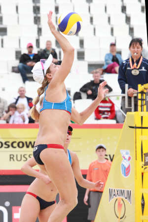 jennifer: MOSCOW, RUSSIA - JUNE 8: Match of Jennifer Kessy (jumps) and April Ross (stands), USA against Emilia and Erika Nystrom, Finland, during Beach Volleyball Swatch World Tour in Moscow, Russia at June 8, 2012
