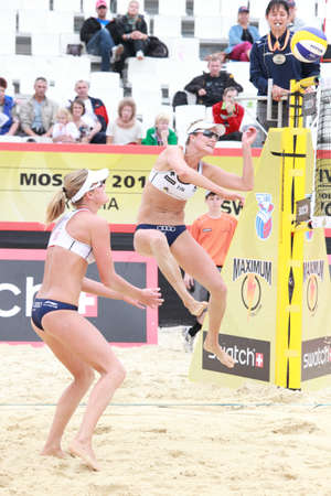 jennifer: MOSCOW, RUSSIA - JUNE 8  Match of Jennifer Kessy and April Ross, USA against Emilia  jumps  and Erika  stands  Nystrom, Finland, during Beach Volleyball Swatch World Tour in Moscow, Russia at June 8, 2012