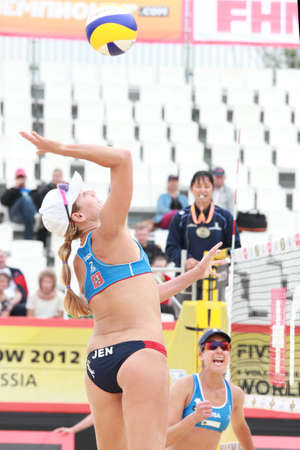 jennifer: MOSCOW, RUSSIA - JUNE 8  Match of Jennifer Kessy  jumps  and April Ross  stands , USA against Emilia and Erika Nystrom, Finland, during Beach Volleyball Swatch World Tour in Moscow, Russia at June 8, 2012 Editorial