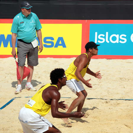 MOSCOW, RUSSIA - JUNE 8  Thiago Santos Barbosa  closer  and Rhooney de Oliveira Ferramenta  further , Brazil vs Christopher McHugh and Joshua Slack, Australia, during Beach Volleyball Swatch World Tour in Moscow, Russia at June 8, 2012