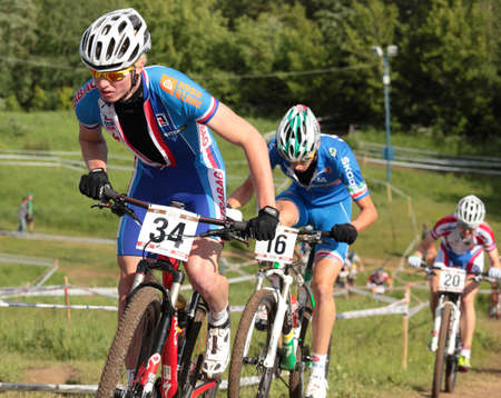 daniele: MOSCOW, RUSSIA - JUNE 9: Jan Nesvadba (Czech Republic, left), Daniele Braidot (Italy, center) and Ivan Smirnov (Russia) in the European Mountain Bike Cross-Country Championship in Moscow, Russia at June 9, 2012