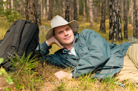 Backpacker resting in a pine forest photo