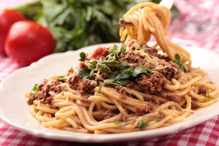Spaghetti alla bolognese on a rustic table photo