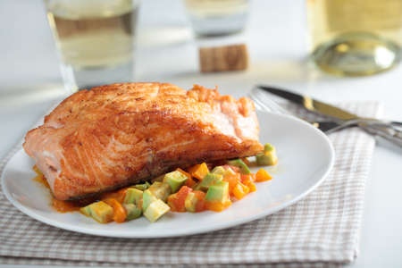 Roasted salmon with vegetables and wine photo