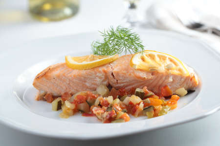 Baked salmon with vegetables and lemon photo
