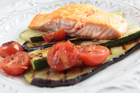 Roasted salmon with zucchini and tomato photo