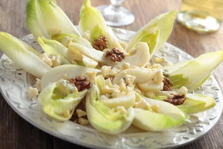 Salad with chicory, blue cheese, walnuts and pears