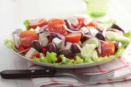 Greek salad on a plate closeup photo