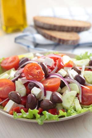 Greek salad on a plate closeup photo