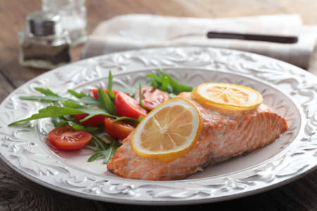 Baked salmon with lemon and salad photo