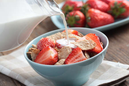 Breakfast with rye bran flakes, strawberry and milk Stock Photo - 14334408