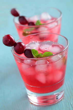 Cranberry juice with berries, ice, and mint photo