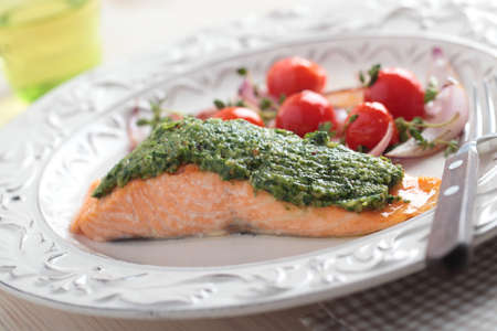 Baked salmon with pesto and vegetables photo