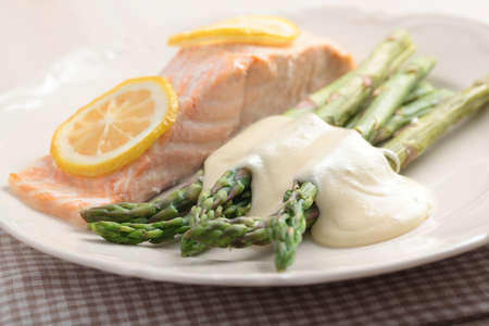 Baked salmon with steamed asparagus under cheese sauce. Shallow DOF Stock Photo - 14334356